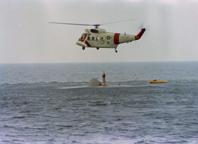 Astronaut John Young hoisted aboard helicopter during water egress training