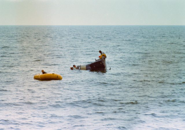 Astronauts Young and Collins during water egress training