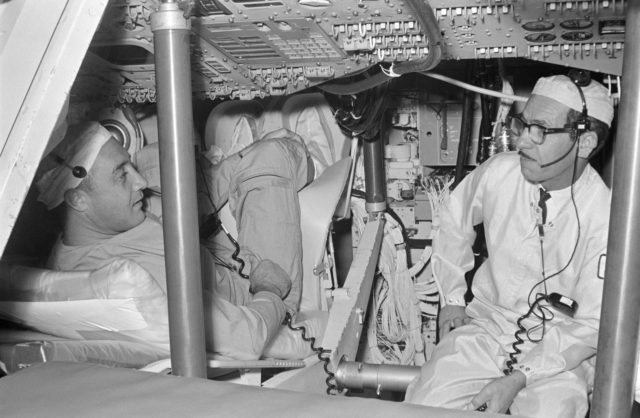 GRISSOM, VIRGIL I., ASTRONAUT - TRAINING - CREW CHECKS SPACECRAFT (S/C) EQUIPMENT - NORTH AMERICAN AVIATION, INC. (NAA), DOWNEY, CA