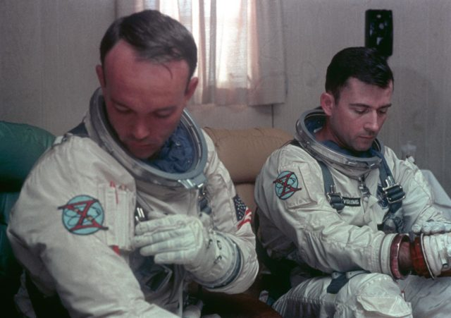 Astronauts Young and Collins undergo suiting up operations during countdown