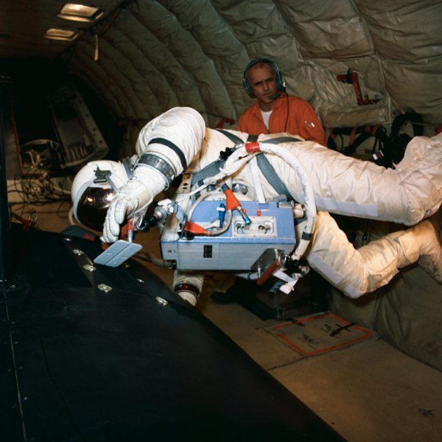 Astronaut Edwin Aldrin practices work task aboard KC-135