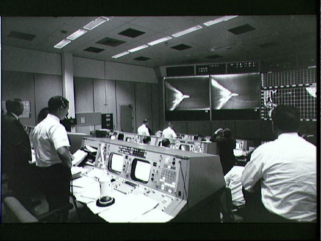 Activity in the Mission Control Room during launch of Apollo 4