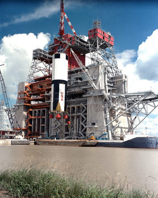 Saturn V First Stage Lifted into Test Stand