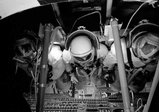 Three astronauts inside Command Module Simulator during Apollo Simulation