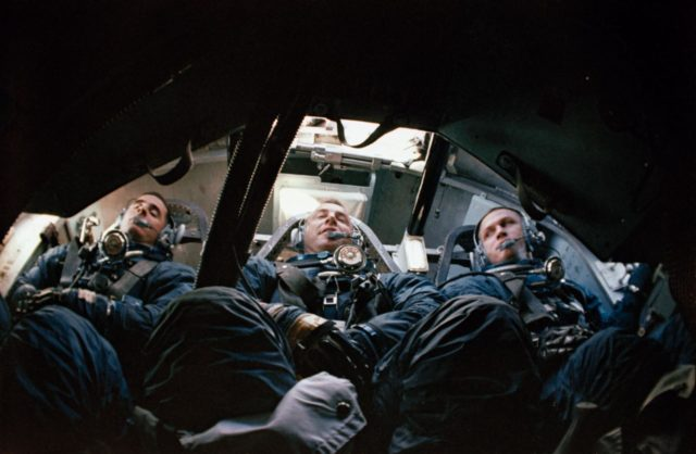 Apollo 8 prime crew seen inside Apollo Boilerplate during water egress