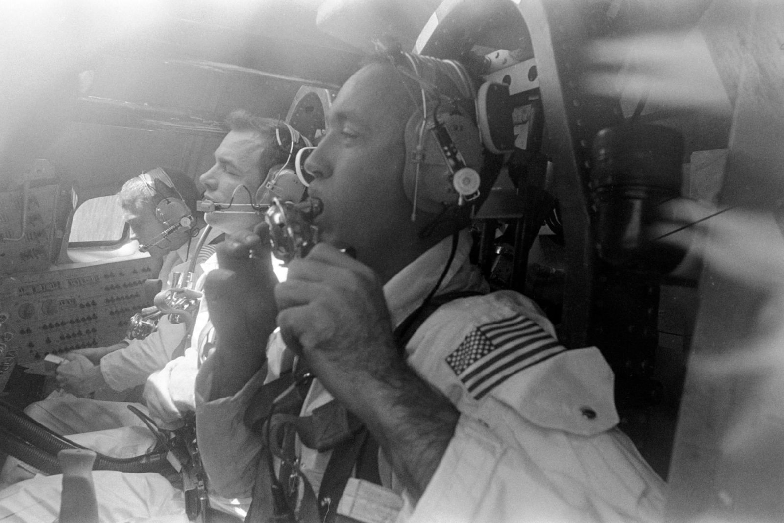 Apollo 9 prime crew inside Apollo command module boilerplate during training