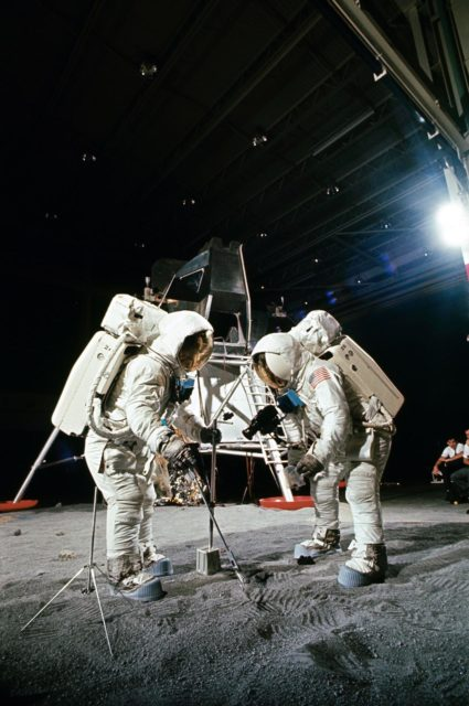 Apollo 11 crewmembers participates in simulation of moon's surface