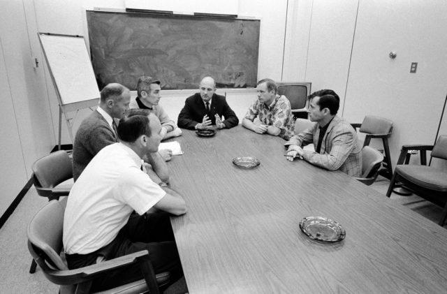 Apollo 10 and 11 crews photographed during Apollo 10 debriefing