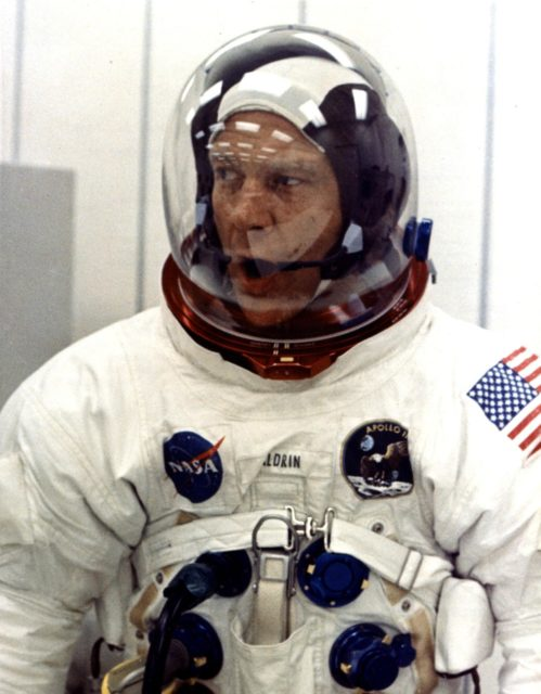 KENNEDY SPACE CENTER, FLA. -- Apollo 11 astronaut Edwin E. Aldrin Jr. appears to be relaxed during suiting operations in the Manned Spacecraft Operations Building (MSOB) prior to the astronauts' departure to Launch Pad 39A. The three astronauts, Edwin E. Aldrin Jr., Neil A. Armstrong and Michael Collins, will then board the Saturn V launch vehicle, scheduled for a 9:32 a.m. EDT liftoff, for the first manned lunar landing mission ksc-69pc-382