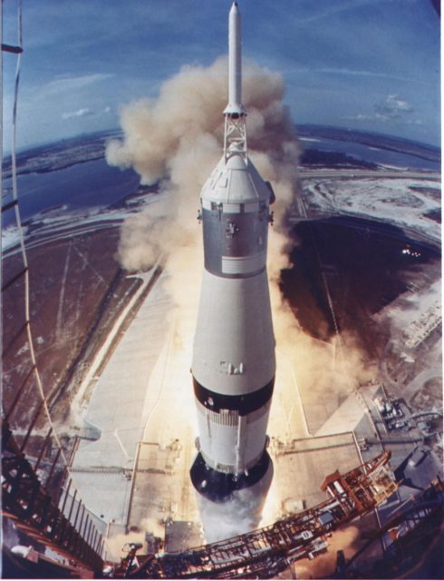 KENNEDY SPACE CENTER, FLA. -- The Apollo 11 Saturn V space vehicle lifts off with Astronauts Neil A. Armstrong, Michael Collins and Edwin E. Aldrin Jr. at 9:32 a.m. EDT July 16, 1969, from Kennedy Space Center's Launch Complex 39A. During the planned eight-day mission, Armstrong and Aldrin will descend in a lunar module to the Moon's surface while Collins orbits overhead in the command module. The two astronauts are to spend 22 hours on the Moon, including two and one-half hours outside the lunar module. They will gather samples of lunar material and willl deploy scientific experiments which will transmit data about the lunar environment. They will rejoin Collins in the command module for the return trip to Earth ksc-69pc-420