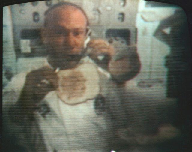 Astronaut Edwin Aldrin makes sandwich in zero gravity condition