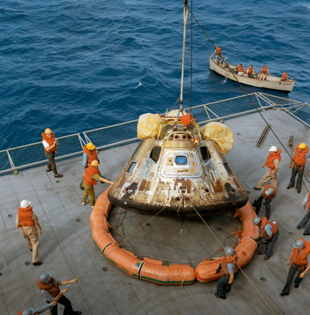 Apollo 11 spacecraft Command Module hoisted aboard U.S.S. Hornet
