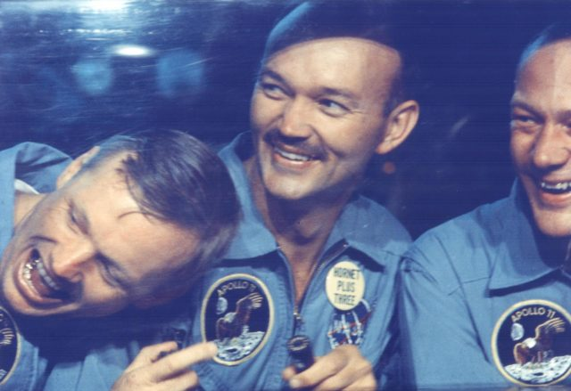 KENNEDY SPACE CENTER, FLA. - The Apollo 11 astronauts, left to right, Neil A. Armstrong, Michael Collins and Edwin E. Aldrin Jr. share jokes with well-wishers on the other side of the window of their Mobile Quarantine Facility aboard the USS Hornet.  The astronauts splashed down at 12:50 p.m. EDT at the completion of their historical eight-day first manned lunar landing. KSC-69PC-429