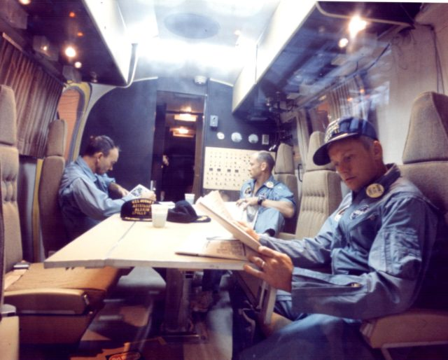 KENNEDY SPACE CENTER, FLA. - Within the Mobile Quarantine Facility, Apollo 11 astronauts (left to right) Michael Collins, Edwin E. Aldrin Jr. and Neil A. Armstrong relax following their successful lunar landing mission.  They spent two-and-one-half days in the quarantine trailer enroute from the USS Hornet, prime recovery ship, to the Lunar Receiving Laboratory at the Manned Spacecraft Center in Houston.  The Hornet docked at Pearl Harbor where the trailer was transferred to a jet aircraft for the flight to Houston. KSC-69PC-484