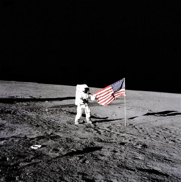 Conrad Unfurls Flag
