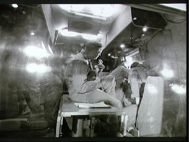 Interior view of Mobile Quarantine Facility with Apollo 11 crewmembers