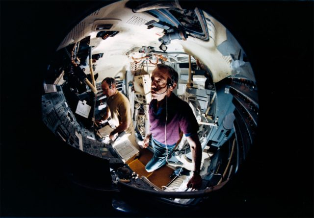 Fish-eye lens view Astronauts Shepard and Mitchell in Lunar Module Simulator