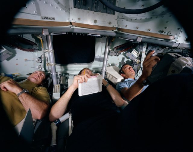 View of Apollo 14 crewmen in Command Module simulation training