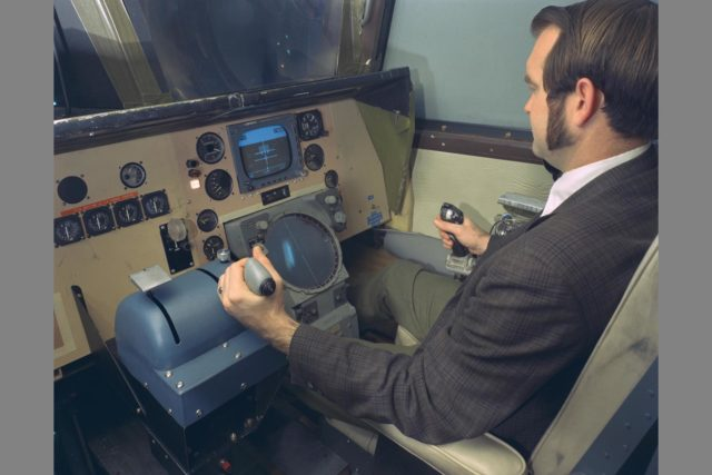 PILOT KENNETH C. WHITE IN CHAIR.  Space Shuttle Vehicle Simulation. SSV COCKPIT IN THE MOVING-CAB TRANSPORT SIMULATOR (S.16) ARC-1970-AC70-5441