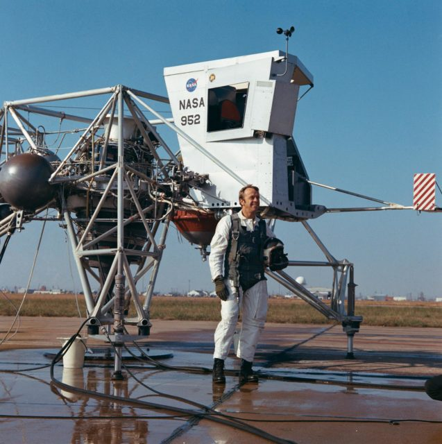 Astronaut Alan Shepard near Lunar Landing Training Vehicle prior to test
