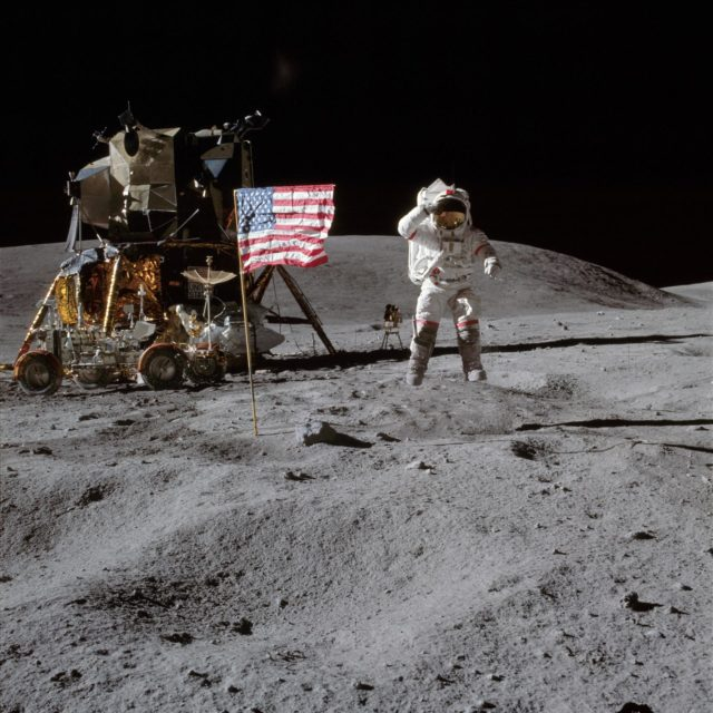 Astronaut John Young leaps from lunar surface to salute flag
