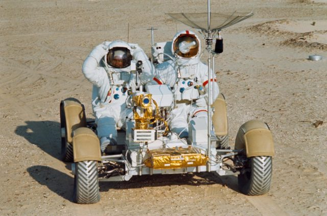 Astronauts Scott and Irwin shown on Lunar Roving Vehicle at KSC
