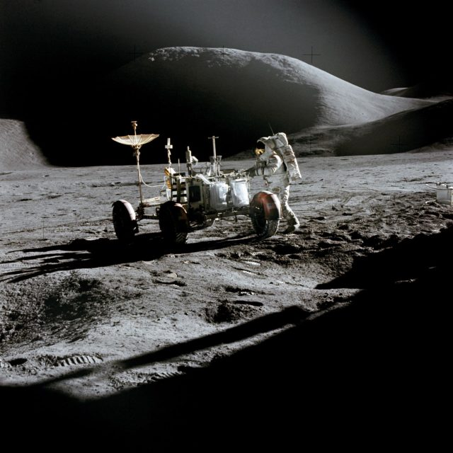 Astronaut James Irwin works at Lunar Roving Vehicle during Apollo 15 EVA