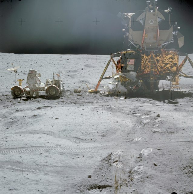 Astronaut John Young at LRV prior to deployment of ALSEP during first EVA
