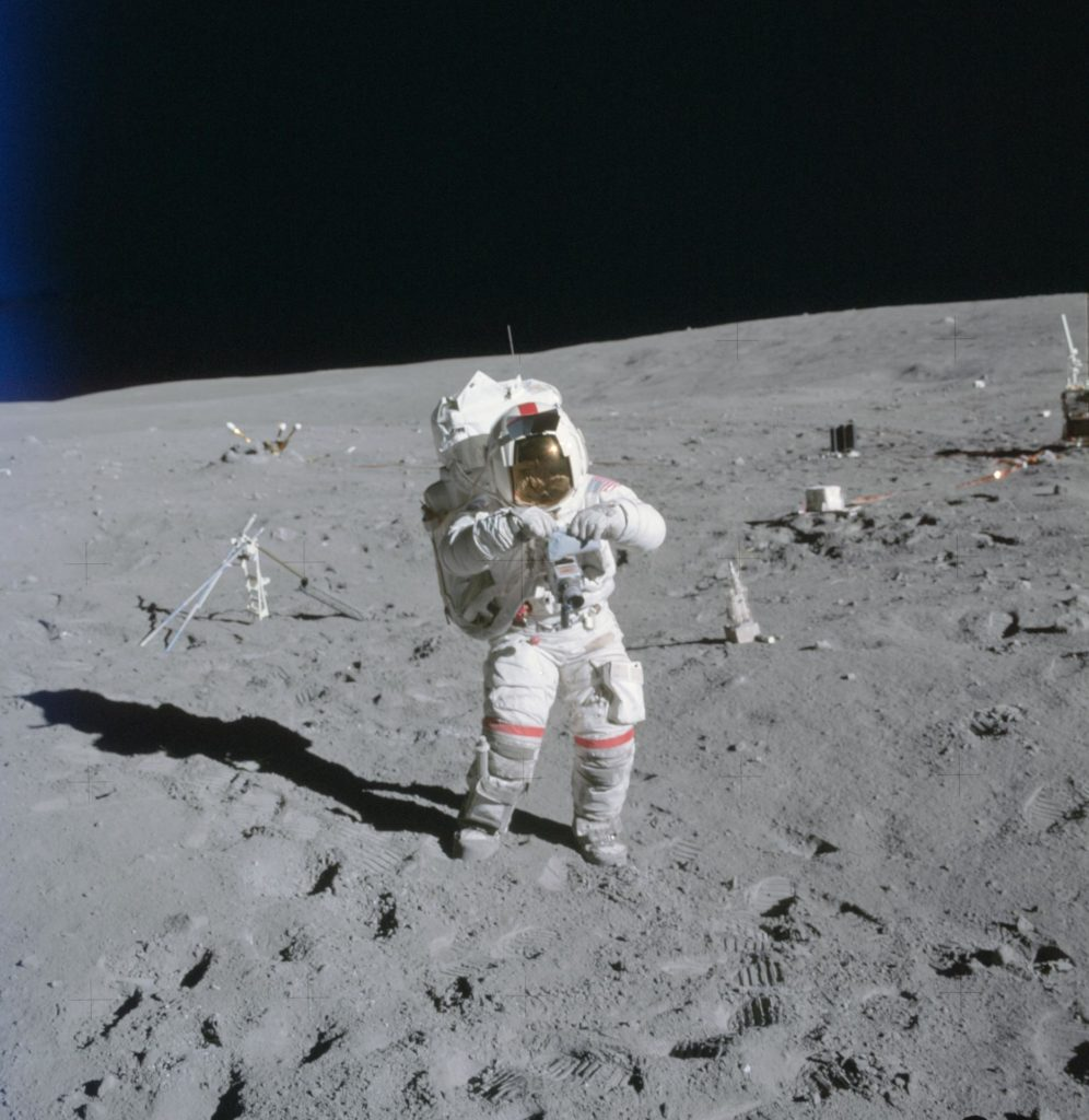 Astronaut John Young stands at ALSEP deployment site during first EVA