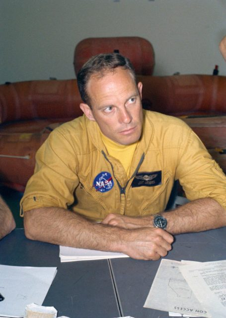Astronaut Jack Lousma at table with crew and flight surgeon before training