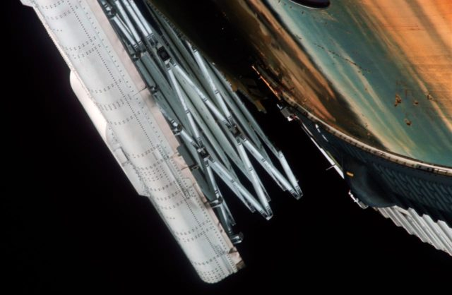 Close-up view of partially deployed, damaged solar array