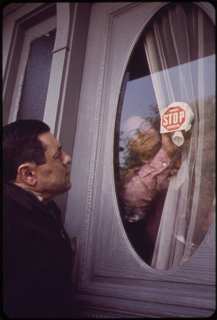 Anthony Bruno Affixes a Protest Sticker to the Front Door of His Neptune Road House