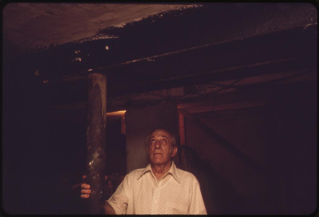 Bernard Picarello Touches Steel Beam He Installed in 1967 When the Original 8x8 Wooden Beam (Shown behind Him) Began to Crack
