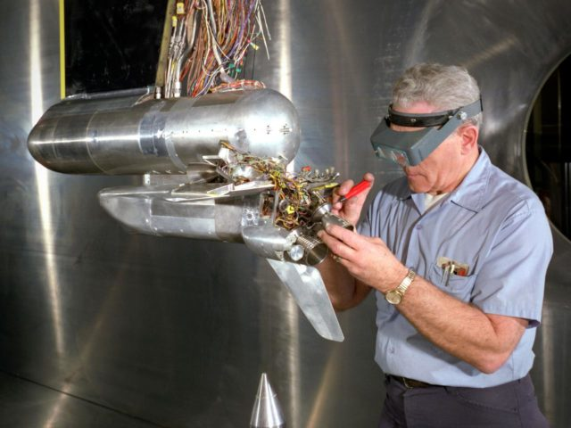 Technician Works on a Shuttle Model in the 10- by 10-Foot Supersonic Wind Tunnel