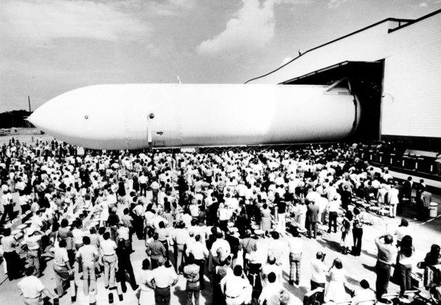 The first Space Shuttle External Tank, the Main Propulsion Test Article (MPTA), rolls off the assembly line September 9, 1977 at the Michoud Assembly Facility in New Orleans. The MPTA was then transported to the National Space Technology Laboratories in southern Mississippi where it was used in the first static firing of the three main engines. Marshall Space Flight Center had management responsibility for Space Shuttle propulsion elements, including the External Tank. Martin Marietta was the prime contractor who designed and assembled the tanks at Michoud. n/a