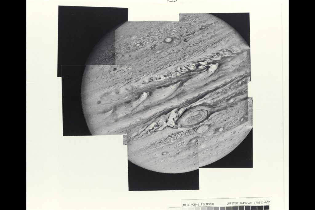This mosaic of Jupiter was assembled from nine individual photos taken through an orange filter by Voyager 1 on Feb. 6, 1979, when the spacecraft was 4.7 million miles (7.8 million kilometers) from Jupiter.  Distortion of the mosaic, especially where portions of the limb have been fitted together, is caused by rotation of the planet during the 96-second intervals between individual pictures.  The large atmospheric feature just below and to the right of center is the Great Red Spot.  The complex structure of the cloud formations seen over the entire planet gives some hint of the equally complex motions in the Voyager 1 time-lapse photography.  The smallest atomospheric features seen in this view are approximately 85 miles (140 kilometers) across.  Voyager project is managed and controlled by Jet Propulsion Laboratory for NASA's Office of Space Science.  (JPL ref. No. P-21146) ARC-1979-A79-7029