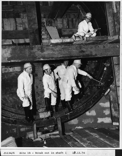 A group of men in a Metro shaft