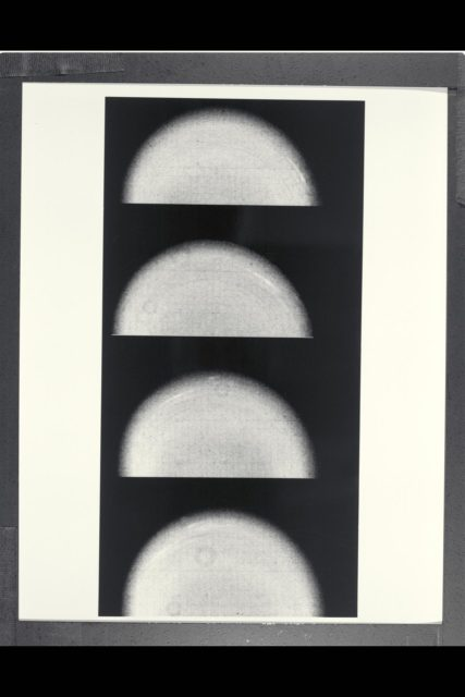 Range :  12.9 million km. ( 8.0 million miles ) P-29467B/W Time lapse Voyager 2 images of Uranus show the movement of two small, bright, streaky clouds, the first such features ever seen on the planet. The clouds were detected in this series of orange filtered images, over a 4.6 hour interval ( from top to bottom ). Uranus, which is tipped on its side with respect to the other planets, is rotating in a counter-clockwise direction, with its pole of rotation near the center of the disk, as are the two clouds seen here as bright streaks. The larger of the two clouds is ata lattitude of 33 degrees. The smaller cloud, seen faintly in the three lower images, lies at 26 degrees ( a lower alttitude and hence closer to the limb). Their counterclockwise periods of rotation are 16.2 and 16.9 hours, respectively. This difference implies that the lower lattitude feature is lagging behind the higher latitude feture at a speed of almost 100 meters pers second (220 mph). Latitudinal bands are also visible in these images, the faint bands, more numerous now then in previous Voyager images from longer range, are concentric with the pole rotation. thatis, they circle the planet in lines of contant latitude. ARC-1981-A86-7007