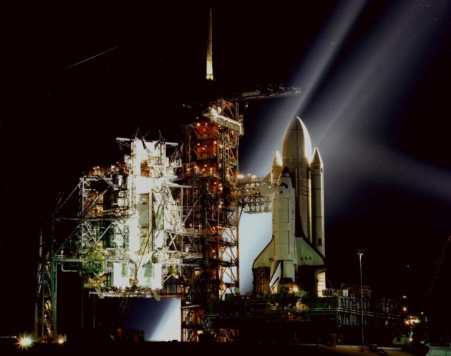 KENNEDY SPACE CENER, FLA. -- A timed exposure of the Space Shuttle at Launch Pad A, Complex 39, turns the space vehicle and support facilities into a night-time fantasy of light. To the left of the Shuttle are the fixed and the rotating service structures ksc-81pc-137