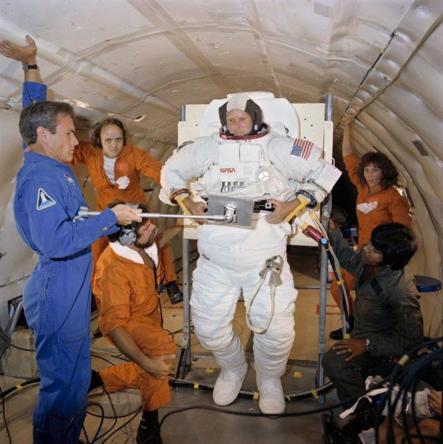Astronaut C. Gordon Fullerton in suit donning/doffing exercise