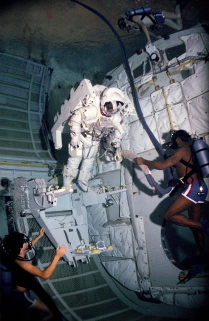 Astronaut Bruce McCandless during an underwater test MMU/FSS in bldg 29 WETF