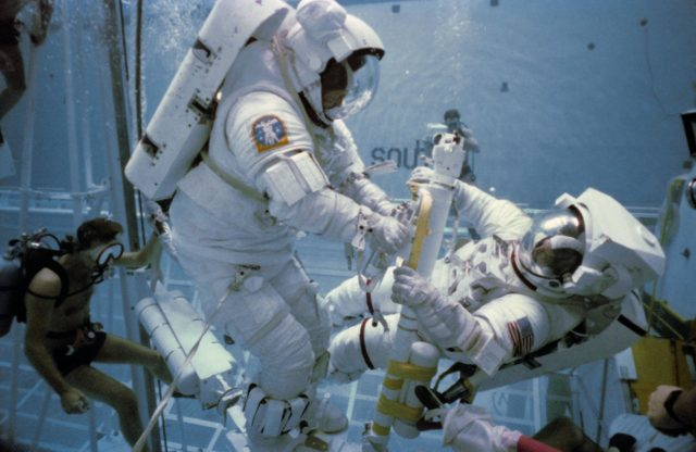 Underwater EVA training in the WETF with astronauts Nelson and van Hoften