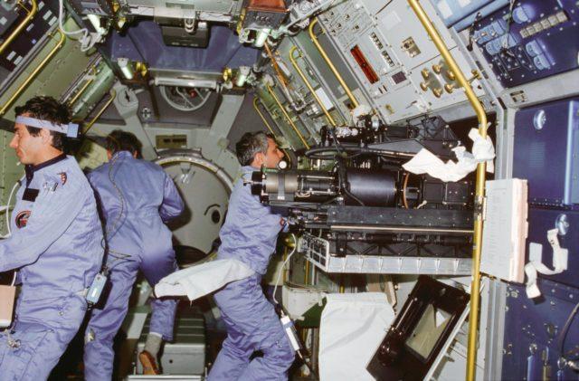 STS-9 crewmembers work in the Spacelab 1 module