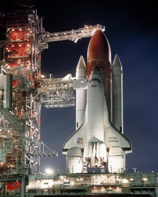 CAPE CANAVERAL, Fla. -- At the Kennedy Space Center in Florida, the rotating service structure has pulled back to the prelaunch position, the shuttle Challenger sits at Launch Pad 39-A bathed in billion candlepower searchlights ready to embark on it fourth space mission STS-41B, the 10th flight of the space shuttle. Photo Credit: NASA KSC-84PC-0080