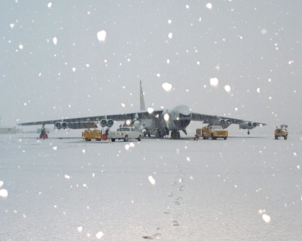 Space Shuttle Solid Rocket Booster Drop Test Vehicle (SRB-DTV) mated to NB-52B in snow EC84-32107