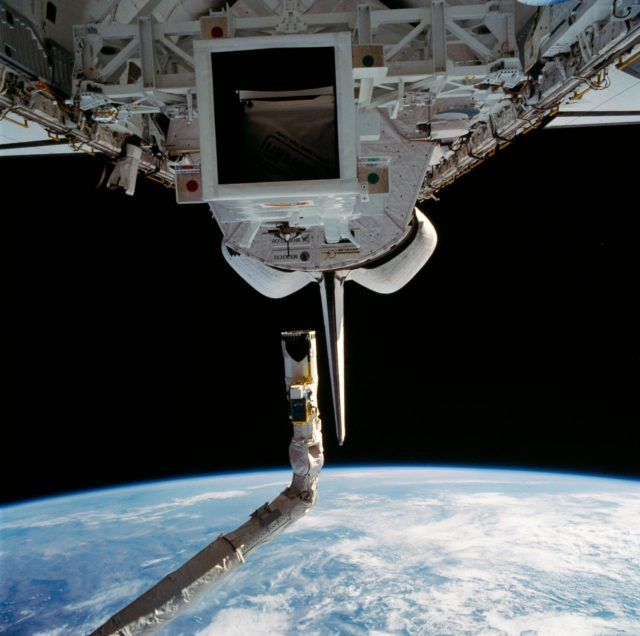 Spartan 1 satellite sits in Discovery's payload bay