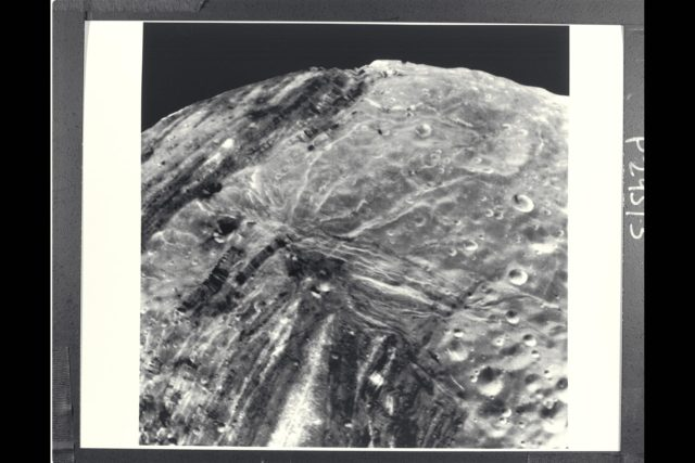 P-29513 BW Range: 31,000 kilometers (19,000 miles) This Voyager 2 image of Miranda was taken shortly before the spacecraft's closet approach to the Uranian moon.The high resolution of 600 meters (2,000 feet) reveals a bewildering variety of fractures, grooves and craters, as well as features of different albedos (reflectances). This clear-filter, narrow-angle view encompasses areas of older, heavily cratered terrain with a wide variety of forms. The grooves and troughs reach depths of a few kilometers and expose materials of different albedos. The great variety of directions of fracture and troughs, and the different densities of impact craters on them, signify a long, complex geologic evolution of this satellite. ARC-1986-A86-7029