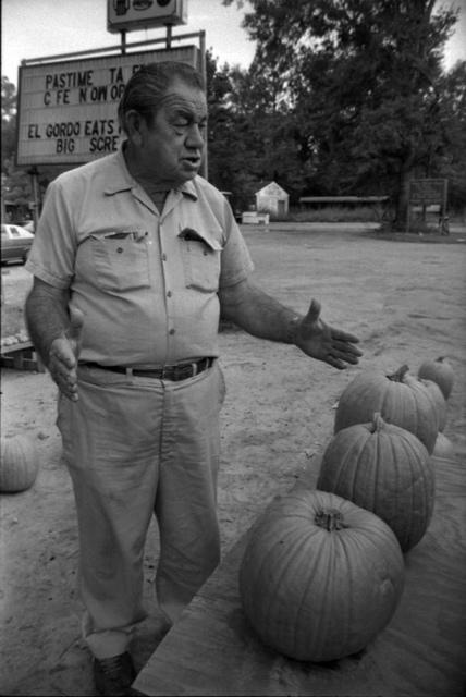Man at a pumpkin stand in Tallahassee, Florida