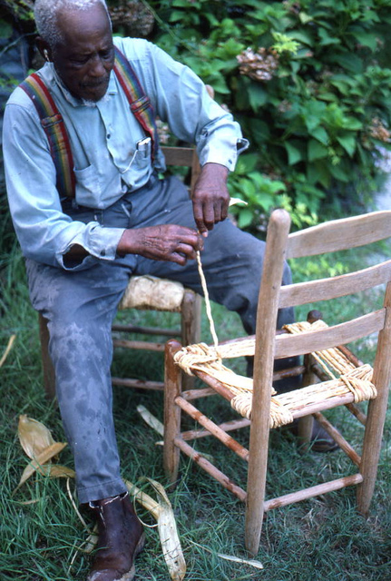 Rufus Adams making a corn shuck chair seat bottom: Mayo, Florida