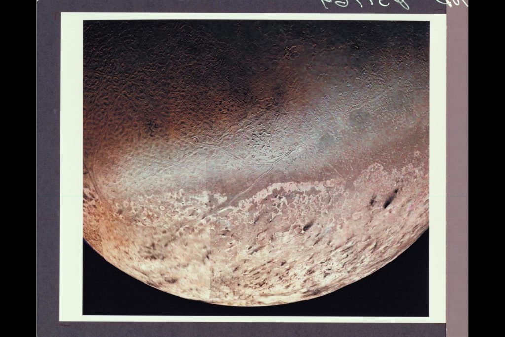 P-34764 Voyager 2 obtained this high resolution color image of Neptune's large satellite Triton  during its close flyby. Approximately a dozen individual images were combined to produce this comprehensive view of  the Neptune-facing hemisphere of Triton. Fine detail is provided by high resolution, clear-filter images, with color information added from lower resolution frames. The large south polar cap at the bottom of the image is highly refective and slightly pink in color , and may consist of a slowly evaporating layer of nitrogen ice deposited during the previous winter. From the ragged edge of the polar cap northward the satellite's face is generously darker and redder in color. This coloring may be produced by the action of ultraviolet light and magnetospheric radiation upon methane in the atmosphere and surface. Running across this darker region , approximately parallel to the edge of the polar cap, is a band of brighter white material that is almost bluish in color. The underlying topography in this bright band is similiar, however to that in the darker, redder regions surrounding it. ARC-1989-AC89-7046